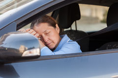Woman sleeping in   car. Royalty Free Stock Image