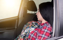 Woman sleeping in the car Royalty Free Stock Photo