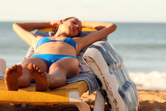 Woman sleeping on the chair stock photography