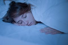 Woman sleeping with closed eyes at night royalty free stock photography