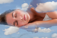 Woman Sleeping. In the clouds and dreaming Royalty Free Stock Image