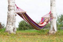 Woman sleeping in colorful hammock Stock Photos