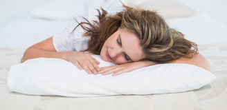 Woman sleeping in cosy bed Royalty Free Stock Photos