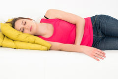 Woman sleeping on a couch Royalty Free Stock Image