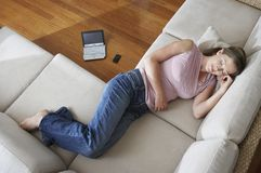 Woman Sleeping On A Couch Stock Photo