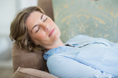 Woman sleeping on couch in living room at home Royalty Free Stock Image
