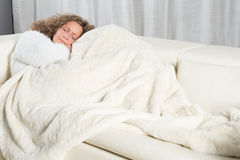 Woman sleeping on couch Royalty Free Stock Photos