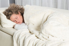Woman sleeping on couch Royalty Free Stock Images