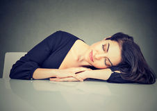 Woman sleeping on a desk royalty free stock photography