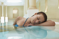 Woman Sleeping On Edge Of Swimming Pool Royalty Free Stock Photos