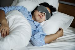 A woman sleeping. With eye mask stock photography
