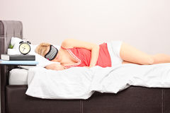 Woman sleeping with eye mask in a bedroom Stock Images