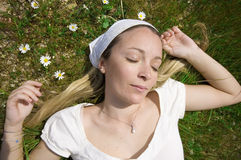 Woman sleeping in field Stock Images