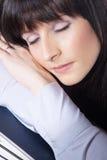 Woman sleeping on file folders Royalty Free Stock Photo