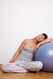 Woman sleeping in fitness studio Royalty Free Stock Images