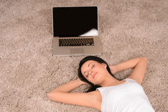Woman sleeping on the floor. Beautiful yoomen sleeping on the fl Stock Photo