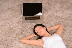 Woman sleeping on the floor. Beautiful yoomen sleeping on the fl Stock Photo