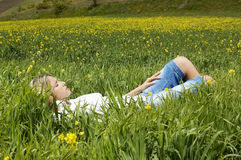 Woman Sleeping On Flower Plants At Field Royalty Free Stock Photos