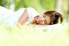 Woman sleeping on grass Royalty Free Stock Photos