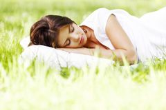 Woman sleeping on grass Stock Images