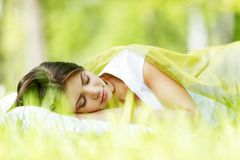 Woman sleeping on grass Royalty Free Stock Photo