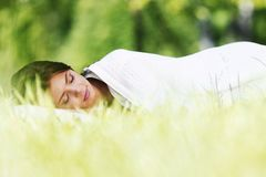 Woman sleeping on grass Royalty Free Stock Images