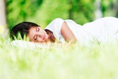 Woman sleeping on grass Royalty Free Stock Photo