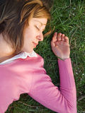 Woman sleeping on the grass Stock Photos