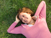 Woman sleeping on the grass Stock Photography