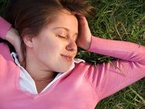 Woman sleeping on the grass Stock Image