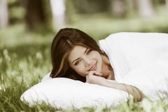 Woman sleeping on grass Royalty Free Stock Image
