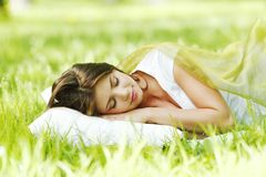 Woman sleeping on grass Stock Photography