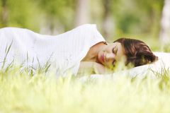 Woman sleeping on grass Royalty Free Stock Photography