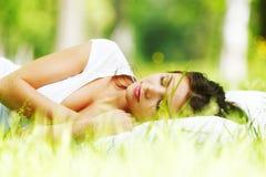 Woman sleeping on grass Stock Image