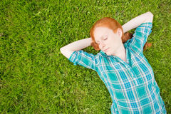 Woman Sleeping on a Green Grass Meadow Stock Photos