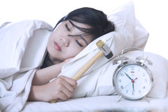 Woman Sleeping with a hammer Royalty Free Stock Photos
