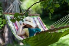 Woman sleeping on a hammock. In garden Royalty Free Stock Photo