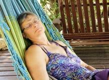 Woman sleeping in a Hammock outdoors. Woman sleeping in a Hammock on Vacation royalty free stock photo
