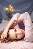 Woman sleeping on her bed at home Stock Photography