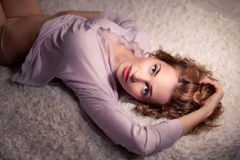 Woman sleeping on her bed at home Royalty Free Stock Photography