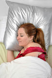 Woman sleeping in her bed Stock Photography