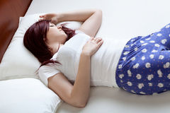 Woman sleeping in her bedroom Royalty Free Stock Images