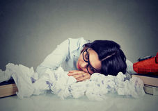 Woman sleeping at her disorganized desk. Young woman sleeping at her disorganized desk Royalty Free Stock Photo