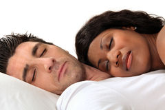 Woman sleeping on her husband. 's chest Royalty Free Stock Photo