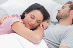 Woman sleeping on her husbands chest Stock Photography
