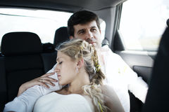 Woman sleeping on her husbands shoulder Royalty Free Stock Photo