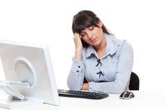 Woman sleeping on her workplace Stock Photo