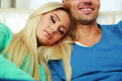 Woman sleeping and hugging man Royalty Free Stock Image