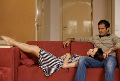 Woman sleeping on husband's lap Stock Images
