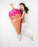 Woman sleeping with ice cream toy and dreaming of Stock Photo